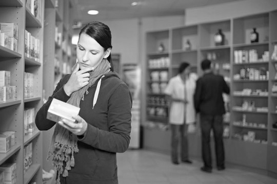 a drug store pharmacist and customers